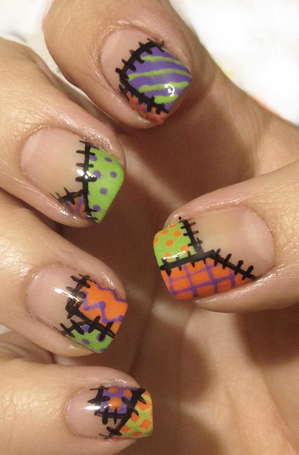 Рисунки красками на ногтях